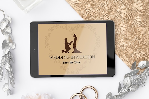 Romantic wedding invitation on a tablet