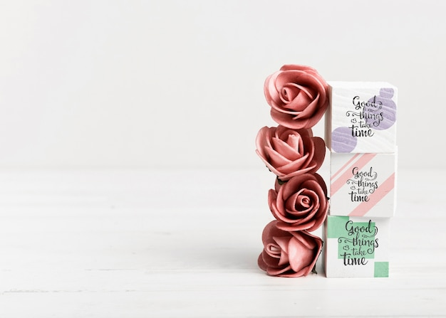 Roses and colorful blocks with copy space