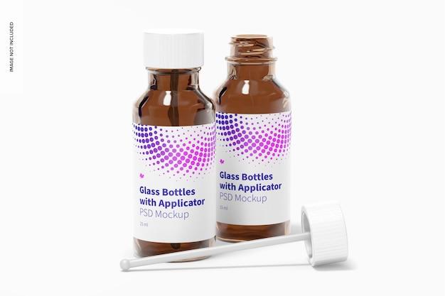 Круглые стеклянные бутылки с макетом стержня аппликатора, вид спереди