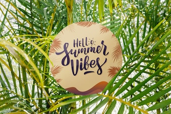 Round paper mockup on palm leaves background