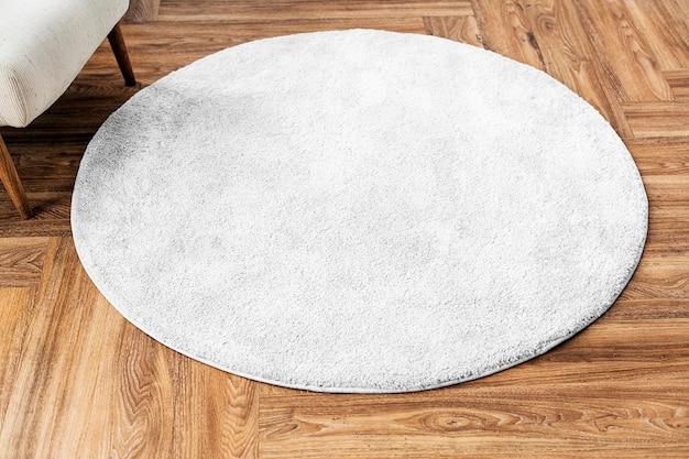 Psd макет круглого коврика на деревянном полу
