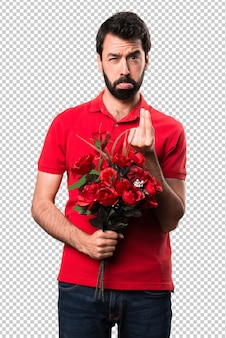 Ruined handsome man holding flowers