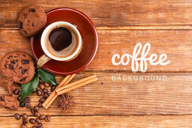 Деревенский фон с чашкой кофе и печеньем