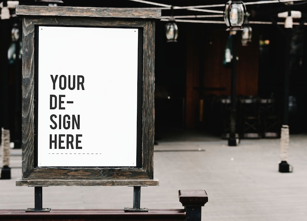 Rustic wooden signboard mockup at a restaurant