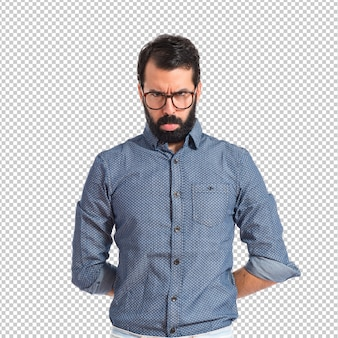 Sad hipster man over isolated white background