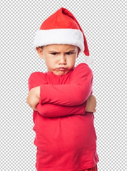 Sad little kid boy celebrating christmas