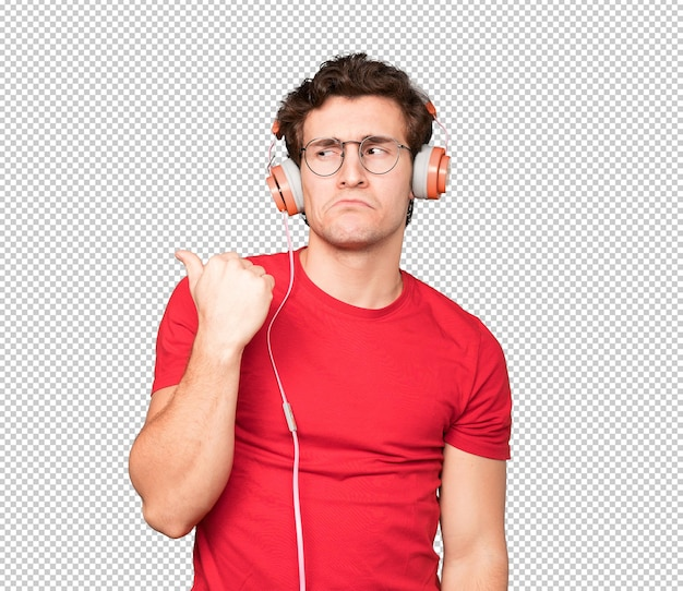 Sad young man using headphones