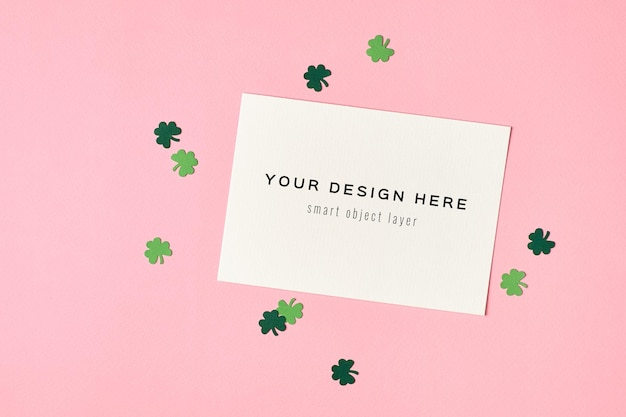 Saint patricks day greeting card mockup with paper clover leaf on green