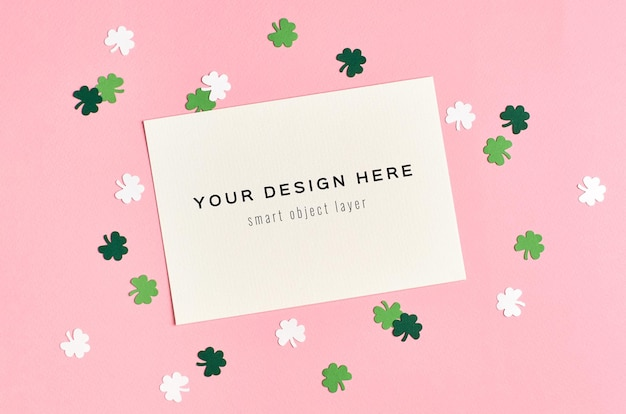 Saint patricks day invitation card mockup with paper clover leaf on green