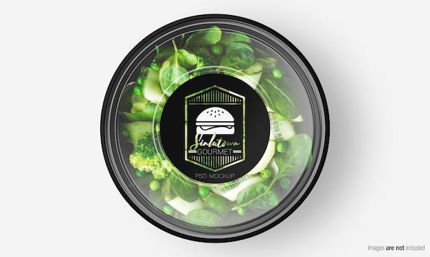Мокап коробки для салата с этикеткой на зеленом салате