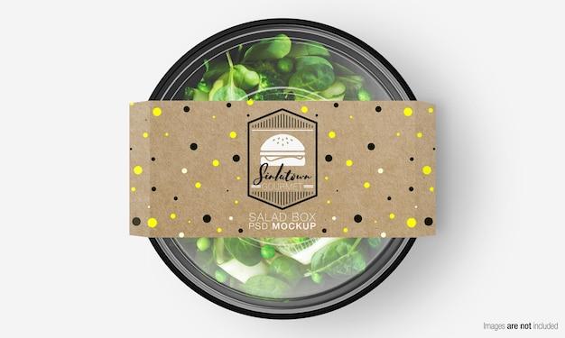 Мокап коробки для салата с бумажной крышкой на зеленом салате