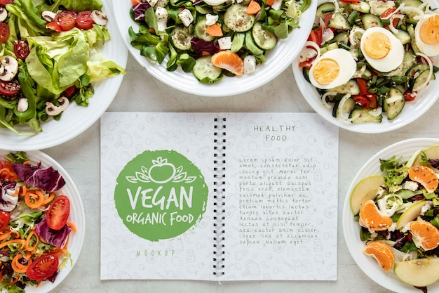 Salads with notebook on desk