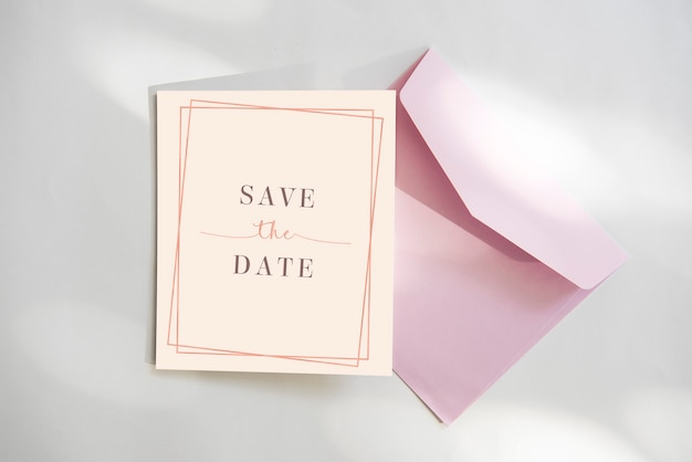 Save the date card with pink envelope
