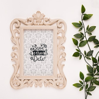 Save the date mock-up baroque frame with leaves