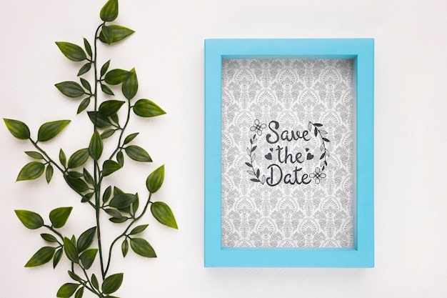 Save the date mock-up blue frame and plant