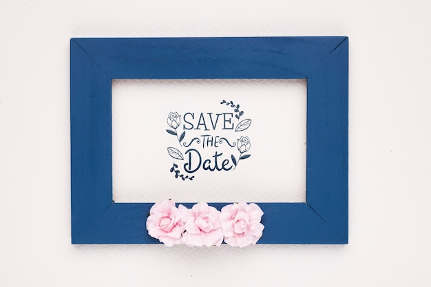 Save the date mock-up dark blue frame and roses
