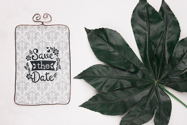 Save the date mock-up and fresh natural leaf
