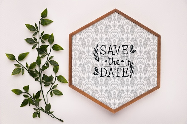 Save the date mock-up hexagonal frame with leaves