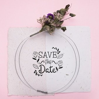 Save the date mock-up on paper with dried flowers