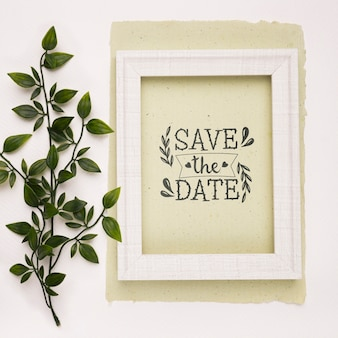 Save the date mock-up picture frame and leaves