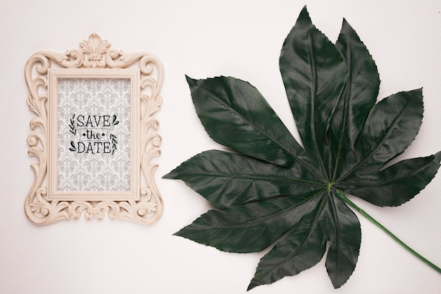 Save the date mock-up vintage frame and leaf
