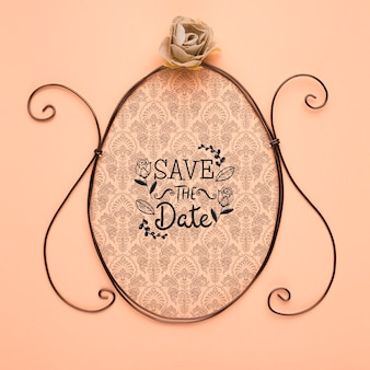 Save the date mock-up vintage frame and silver rose