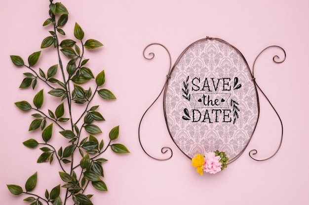 Save the date mock-up vintage frame with flowers and leaves
