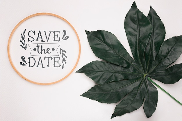 Save the date mock-up with big leaf