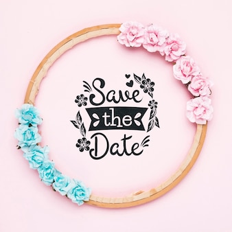 Save the date mock-up with blue and pink roses