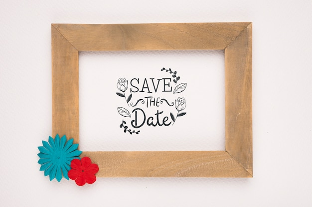 Save the date mock-up wooden frame with colourful flowers