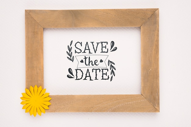 Save the date mock-up wooden frame with yellow flower