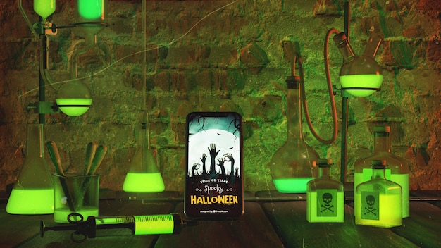 Scary halloween arrangement with smartphone