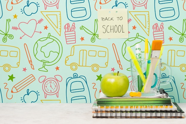 School concept with drawings and green apple