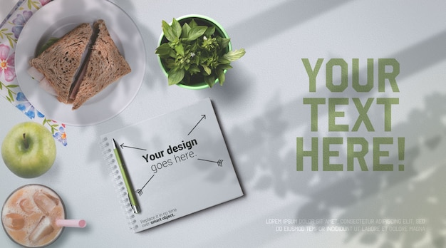 School lunch mockup notebook and healthy food on white table top view