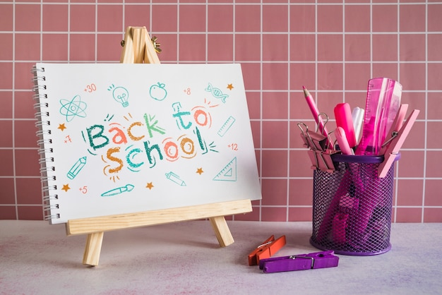 School supplies with wooden painting easel