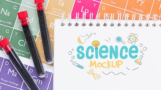 Science elements arrangement with notepad mock-up