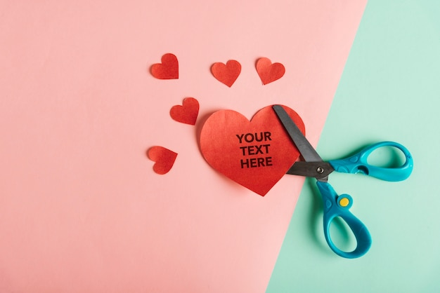 Scissors with paper in heart shapes and copy space