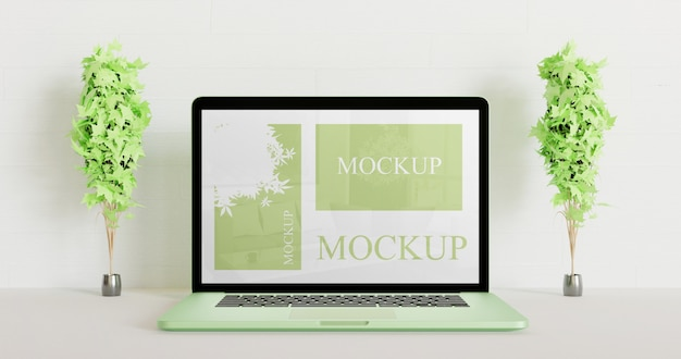 Screen laptop mockup between couple decoration plants. green laptop mockup.