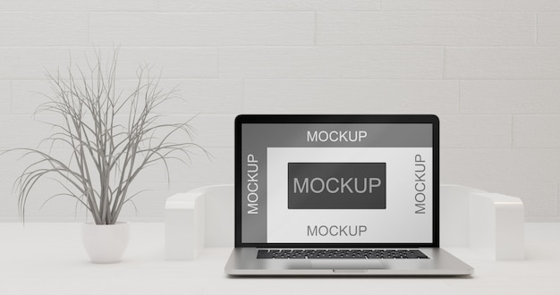 Screen laptop mockup on white surface with abstract dry tree plant