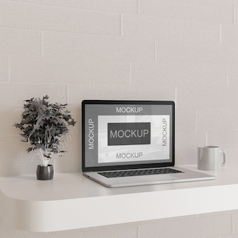 Screen laptop mockup on white wall desk with black decorative