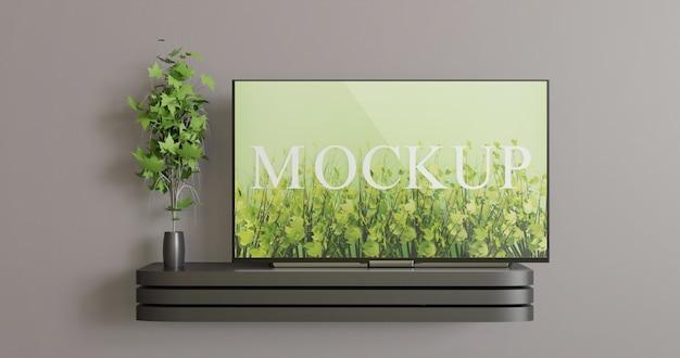 黒い壁のテレビの机の上の画面テレビのモックアップ