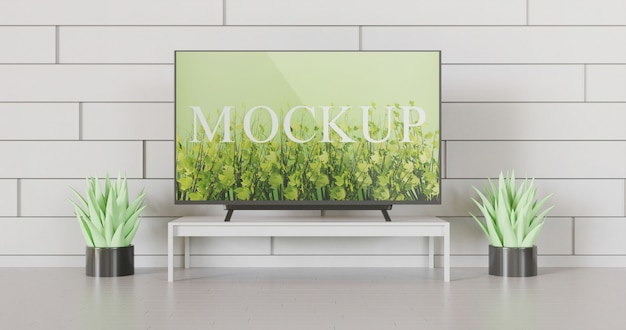 Screen tv mockup on the table between couple succulents