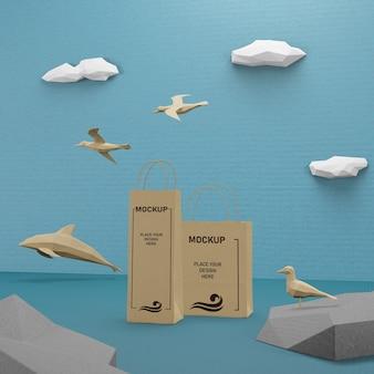 Морская жизнь и концепция бумажных пакетов с макетом