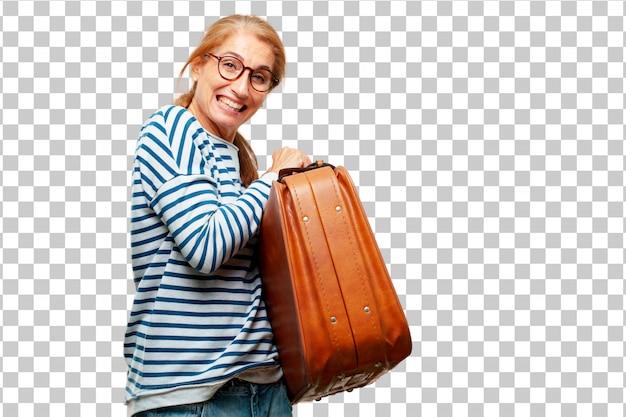 革ケースの荷物を持つシニアの美しい女性