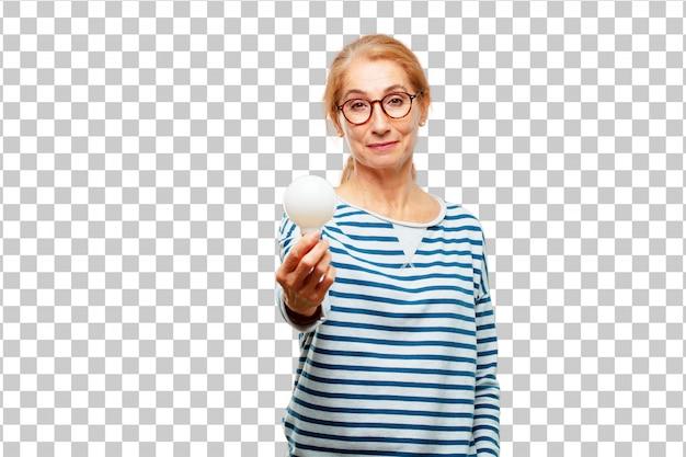 Старший красивая женщина с лампочкой. идея концепции