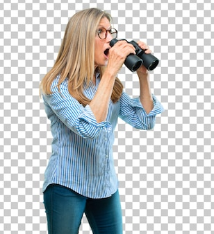 Senior beautiful woman with binoculars