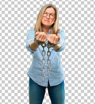 Senior beautiful woman with a chain. freedom concept