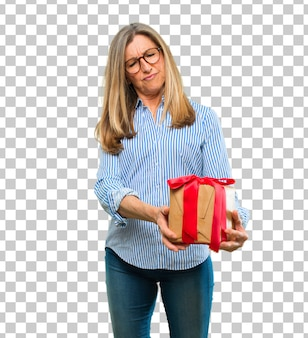 Senior beautiful woman with gift box concept