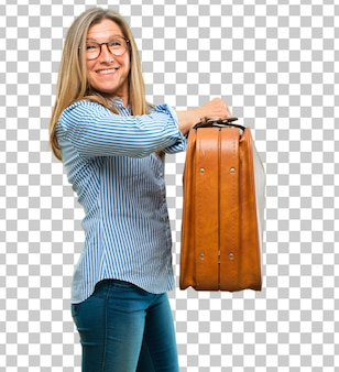 Senior beautiful woman with a leather case luggage