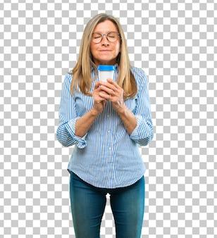 Senior beautiful woman with a take away coffee